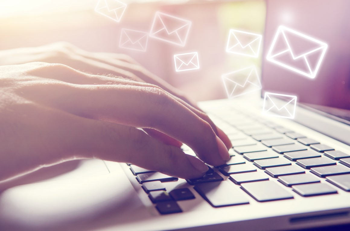Close Up Person hand and Laptop pc with email icon, Email concept. Retro filter effect.